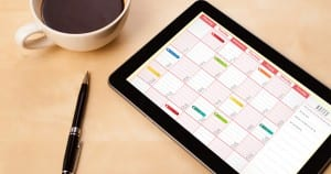 Social media content calendar on a tablet.