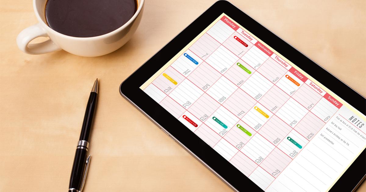 Social media content calendar on a tablet.