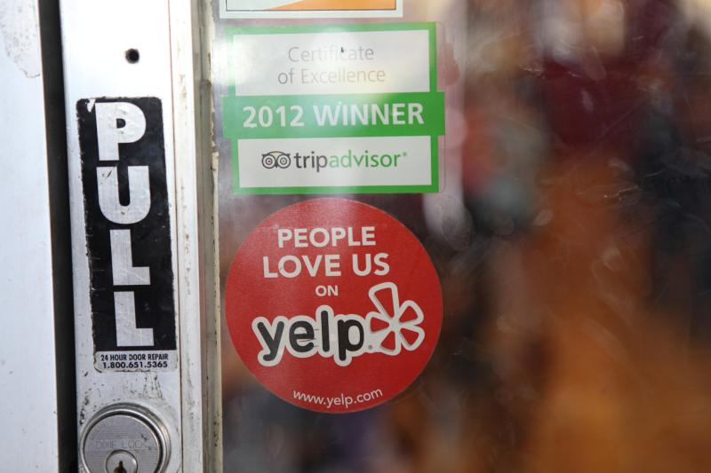"""People Love Us On Yelp"" sign by Michael Dorausch via Flickr using Creative Commons License (https://www.flickr.com/photos/chiropractic/8246725201)"