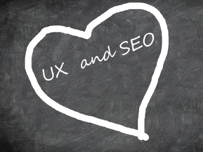 chalk board with a heart and text saying UX and SEO