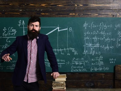 Man in front of chalkboard with math equations