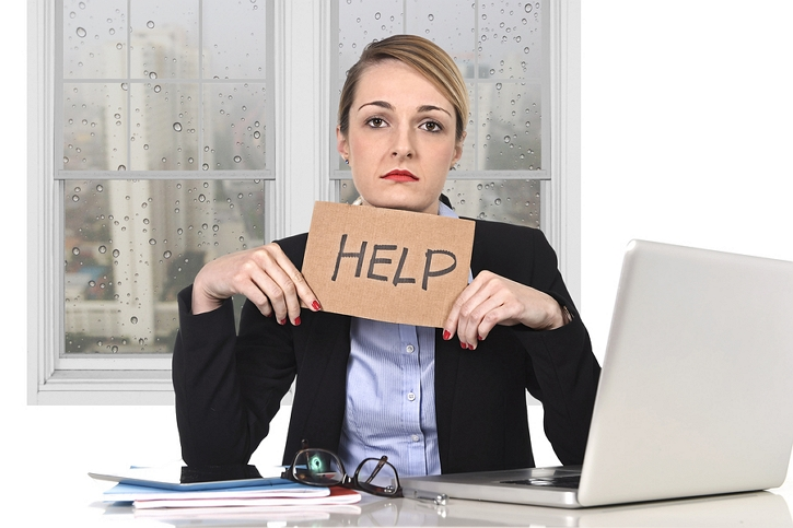 Dental Front Office Staff Holding Help Sign in Need of Marketing Consultant