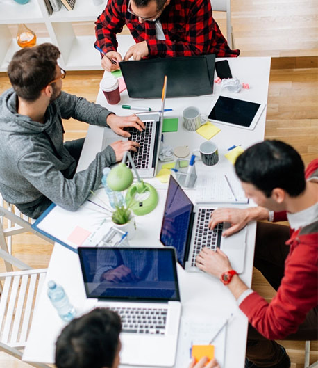 Image of people working at desk